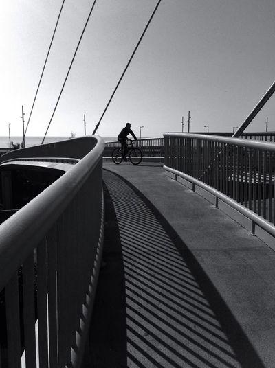 Cyclist on footbridge