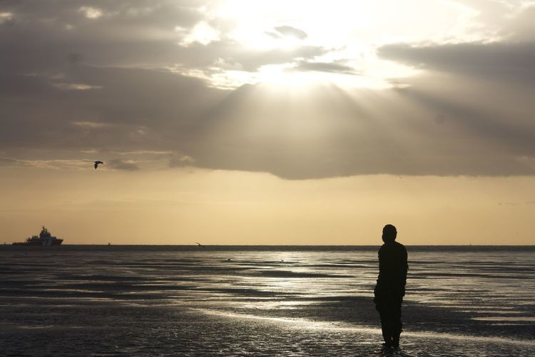 Another Place Another Place By Anthony Gormley Anthony Gormley Cloud Cloud - Sky Crosby Beach Horizon Over Water Outdoors Sculptures Sea Ship Shore Sky Statues Sun Sunlight Thoughtful Tranquility Unrecognizable Person Water