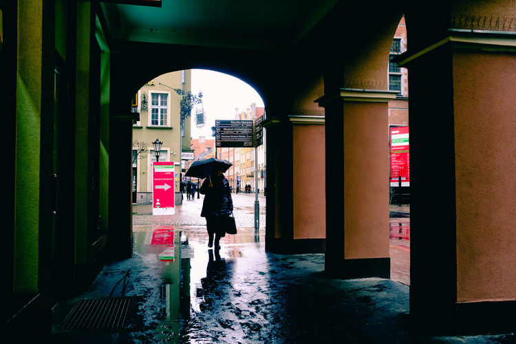 Umbrella lady & the rain. [64/365] 2016.12.12 Architecture Built Structure Candid City City Day Gdansk One Person One Woman Only Outdoors People Poland Rain Rainfall Raining Rainy Days Real People Street Street Photography Streetphotography Walking Walking Around