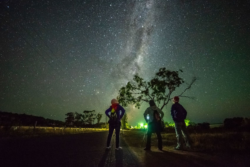 Astrophotographer and stargazing Clear Sky Constellation Galactic Core Astronomy Astrophotography Galactic Center Galaxy Group Of People Leisure Activity Long Exposure Milky Way Nature Night Outdoors People Plant Real People Scenics - Nature Sky Space Standing Star - Space Stargazing Starry Night Tree