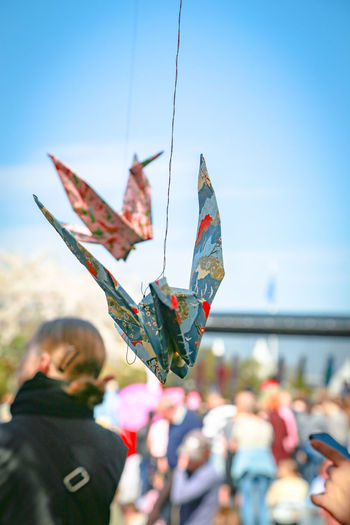 Close-up of colorful origami hanging at public park