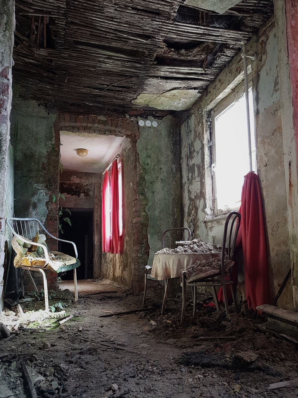 seat, chair, indoors, abandoned, obsolete, window, damaged, absence, no people, old, architecture, run-down, bad condition, built structure, decline, table, day, deterioration, furniture, building, messy, ruined, ceiling