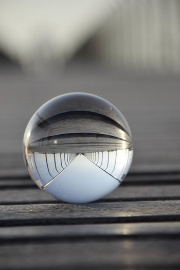 Close-up of crystal ball on wooden table