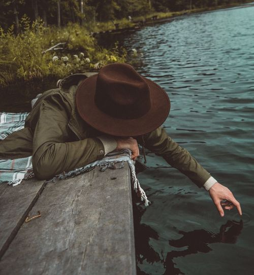 Water Hat Real People One Person Sitting Outdoors Leisure Activity Day Relaxation Lake Nature Lifestyles Men Adult People Adults Only Reflections In The Water Reflections Reflection Folk Folkgood Adventure Lake View Lakeside Lakeview Fresh On Market 2017