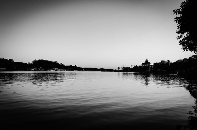 Water Reflection Clear Sky Outdoors Tree Lake Silhouette Tranquil Scene Nature No People Scenics Waterfront Tranquility Sky Day Architecture Beauty In Nature Nature Sunset Tree Beauty In Nature Black And White Friday