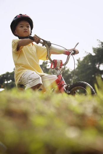 Boy cycling at park