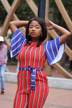 Arms Raised Beautiful Woman Day Focus On Foreground Front View Hairstyle Human Arm Incidental People Leisure Activity Lifestyles Looking At Camera One Person Outdoors Portrait Real People Red Standing Striped Three Quarter Length Women Young Adult Young Women The Fashion Photographer - 2018 EyeEm Awards
