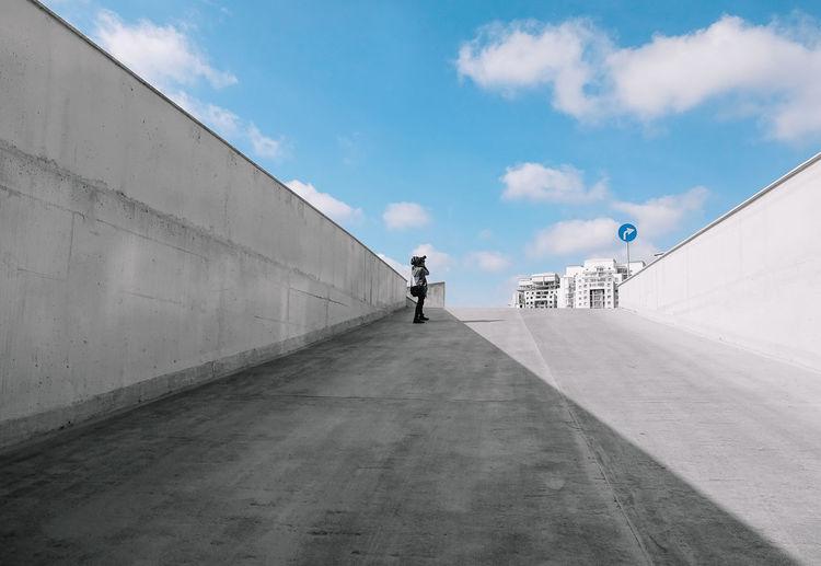 Woman on street against sky
