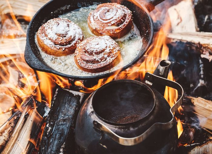 Cinnamon rolls coffee on camp fire. Fireplace Campfire Fire Cinnamonrolls Food EyeEm Selects Drink Golf Club Heat - Temperature Close-up Black Coffee Wood Burning Stove Coffee