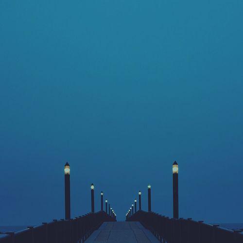 View of street lights on footbridge