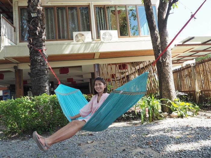 Portrait of a girl sitting on hammock