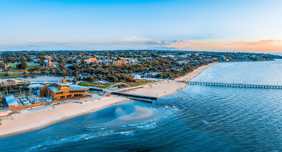 Aerial panorama of frankston yacht club, footbridge and the pier at sunset in melbourne, australia