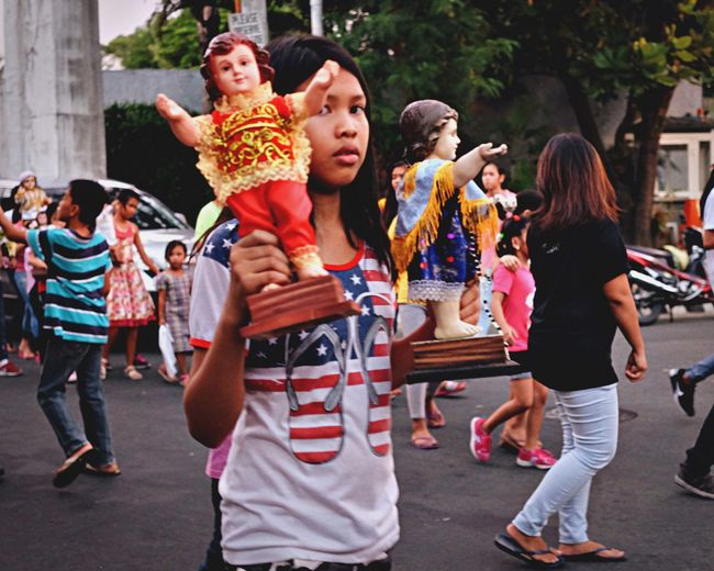 Viva Santo Niño! Devotees from various parts of the country celebrate today the Feast of the Child Jesus (Santo Niño), which is traditionally marked with festive celebrations and grand processions. SantoNiño Parade Parade Religion Catholic Streetphotography