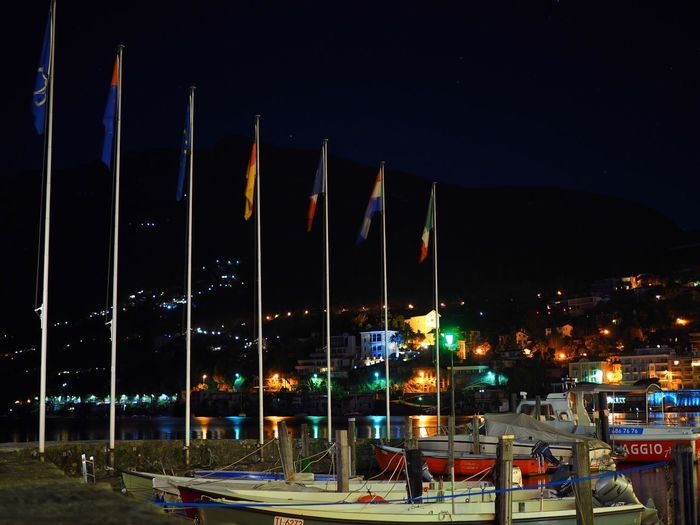 Architecture Boat Boats Flag Harbor Illuminated Lake Night No People Outdoors Reflection Sky Stars