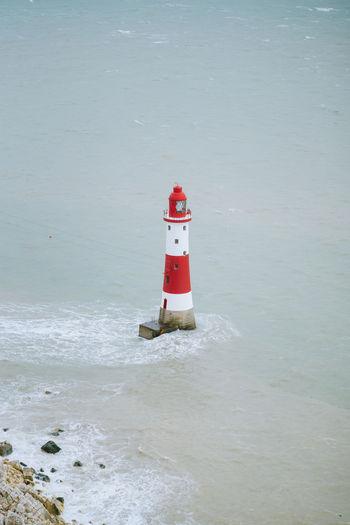 Find more travel inspiration at http://www.instagram.com/simonmigaj Light Lightouse Red Stripes Travel United Kingdom Wave Beach Coast Ocean Peak Sharp Uk Water Waves
