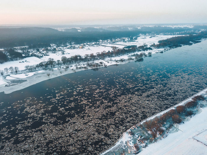High angle view of frozen river in city