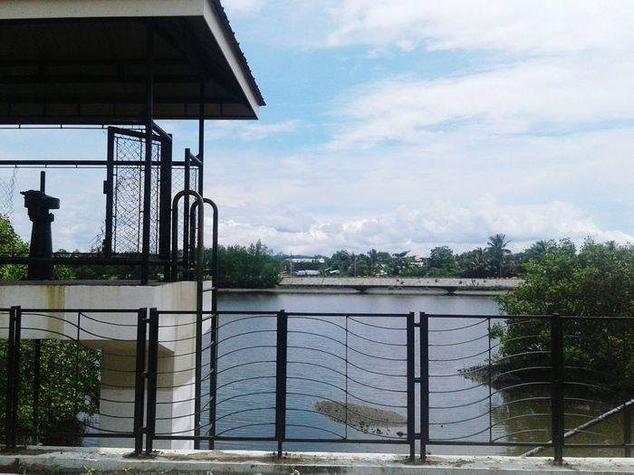 TakeoverContrast Built Structure Railing Architecture Water Building Exterior Sky Cloud Day Cloud - Sky Tranquility Tranquil Scene Outdoors Nature Scenics No People Waterfront PhonePhotography Phone Camera Phoneographer Phonetography Phonegraphy
