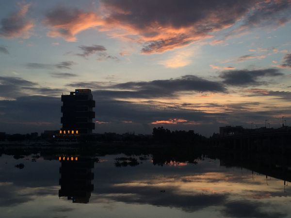 Eyemphotography Architecture Reflection Water Sunset Nature Sky Tree Silhouette Day Outdoors Waterfront Scenics Beauty In Nature No People Cloud - Sky Building Exterior Built Structure