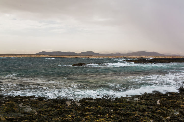 Canarias Colors Fuerteventura Aquatic Sport Beach Beauty In Nature Breaking Cloud - Sky España Island Land Motion Nature Outdoors Power In Nature Rock Rock - Object Scenics - Nature Sea Sky Solid Sport Surfing Water Wave EyeEmNewHere