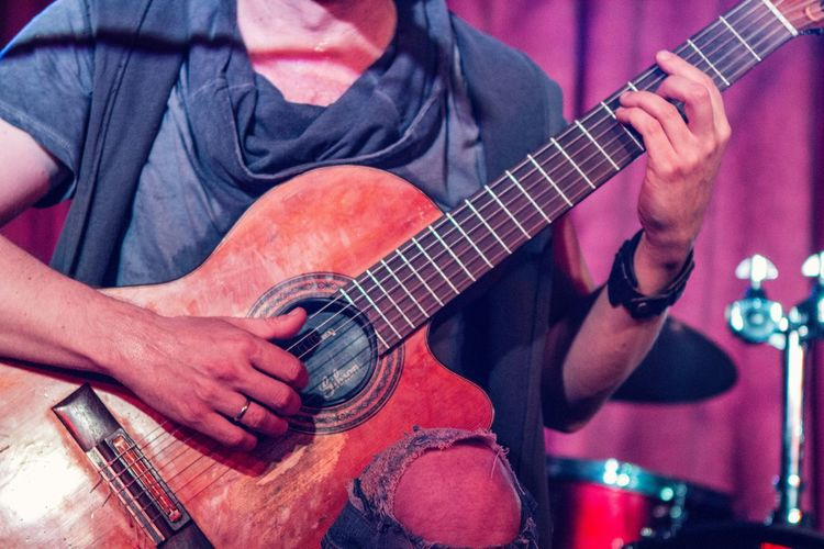 Low Section Of Man Playing Guitar