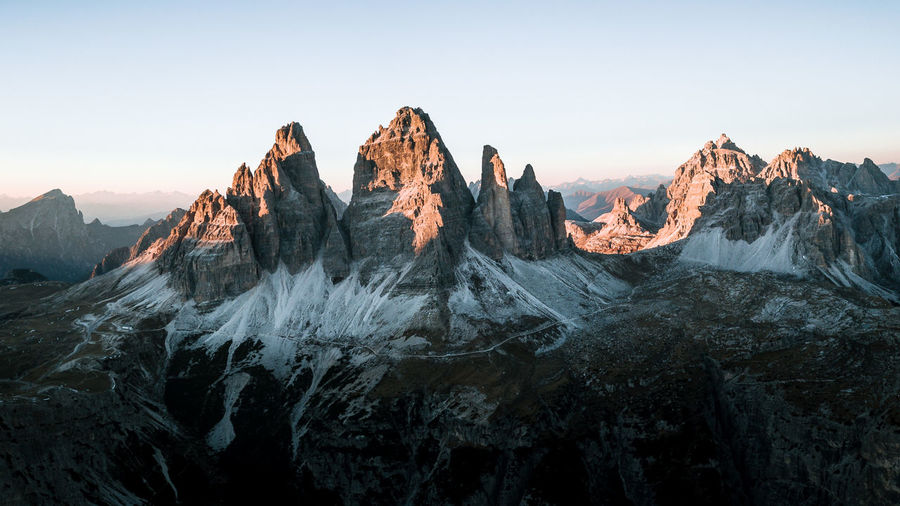 The Week On EyeEm Dji Aerial View Tre Cime Di Lavaredo Dolomites, Italy Beauty In Nature Day Landscape Mountain Mountain Range Nature No People Outdoors Panoramic Rock - Object Scenics Sky Snow Sunset Travel Destinations Shades Of Winter Fresh On Market 2018 Shades Of Winter