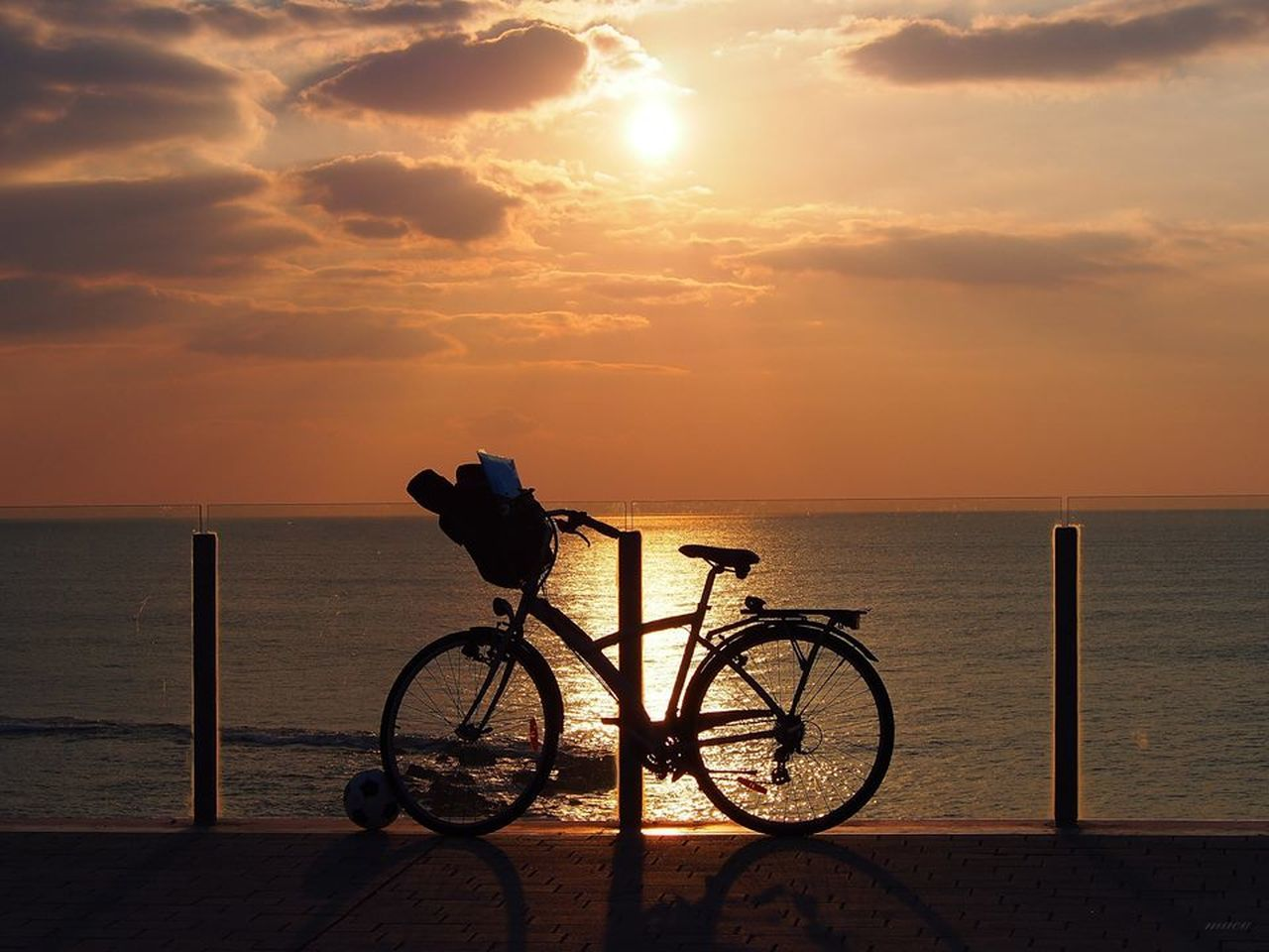 sea, sunset, water, horizon over water, silhouette, nature, sky, bicycle, tranquil scene, beach, scenics, beauty in nature, one person, outdoors, day, people