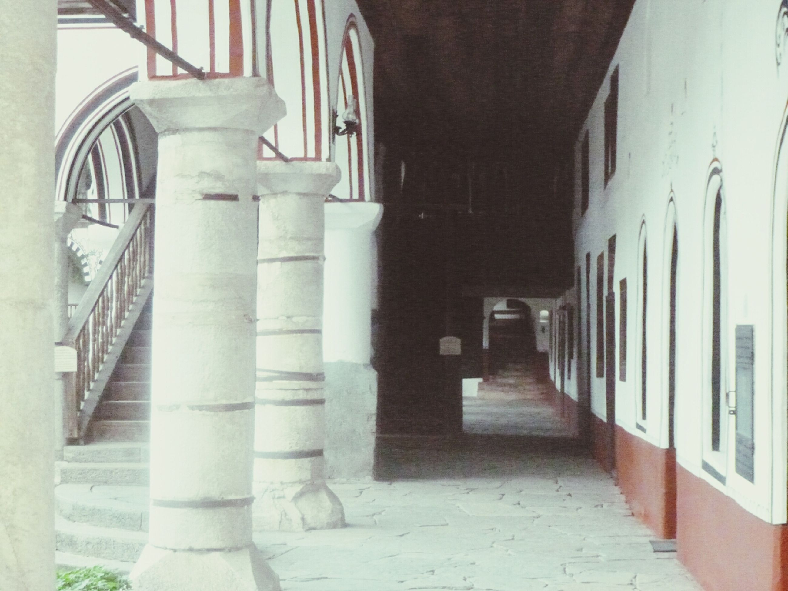 architecture, built structure, building exterior, the way forward, building, steps, narrow, corridor, diminishing perspective, arch, architectural column, column, walkway, steps and staircases, staircase, railing, day, sunlight, in a row, colonnade
