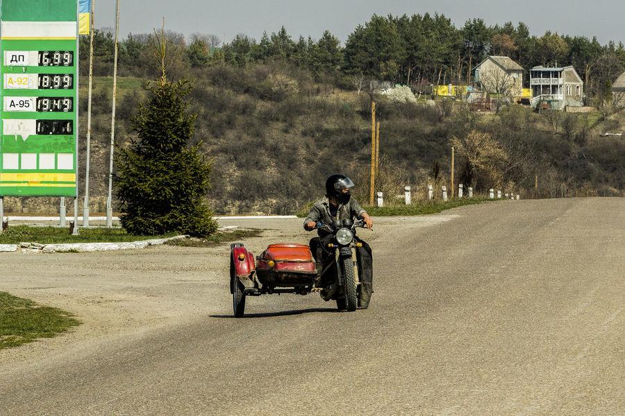 Biker Crash Helmet Headwear Lifestyles Men Mode Of Transport Motorcycle Outdoors Real People Riding Road Transportation