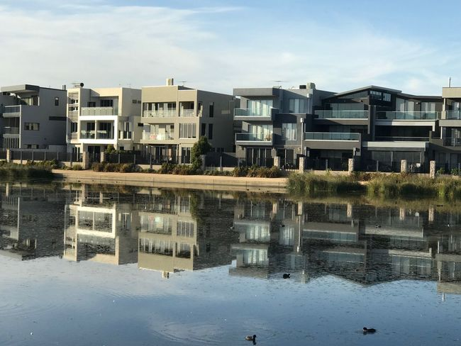 Townhouses Reflections In The Water Built Structure Building Exterior Architecture Reflection Building Water City Residential District Day Sky Apartment Lake Outdoors