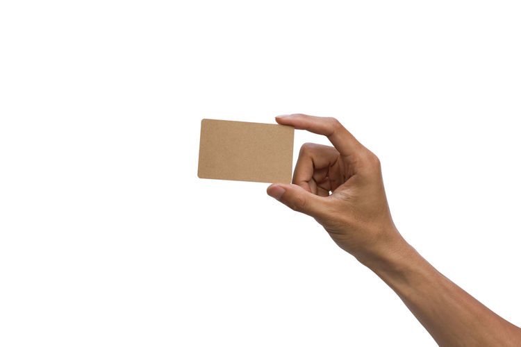 Cropped Hand Holding Business Card Against White Background