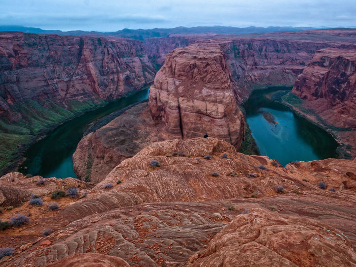 Arid Climate Beauty In Nature Cliff Colorado River Dawn Eroded Extreme Terrain Geology Horseshoe Bend Landscape Nature Page Arizona Physical Geography Remote Rock Rock Formation Rocky Rocky Mountains Rough Scenics Sky Tourism Tranquil Scene Tranquility Travel Destinations Lost In The Landscape Lost In The Landscape