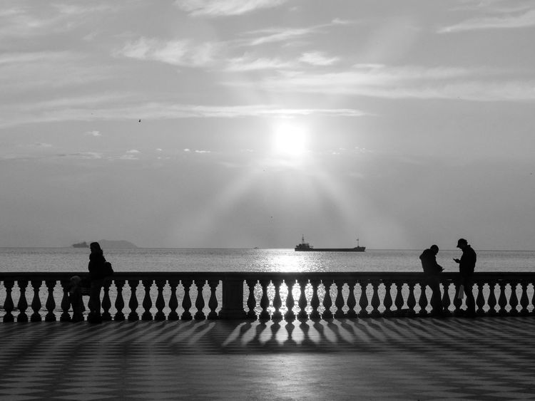 Sunset on Terrazza Mascagni Sea Water Sunlight Sky Full Length Horizon Over Water Beauty In Nature Togetherness Terrazza Mascagni Livorno Leghorn Italy Black And White Reflection Architecture Romantic Sunset Sky Lyfestyle Italian