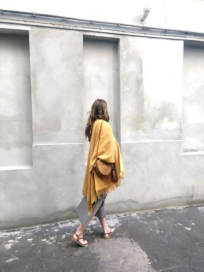 Full length of woman with yellow umbrella