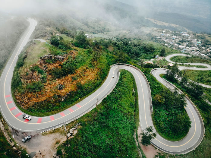Aerial view of roads amidst forest