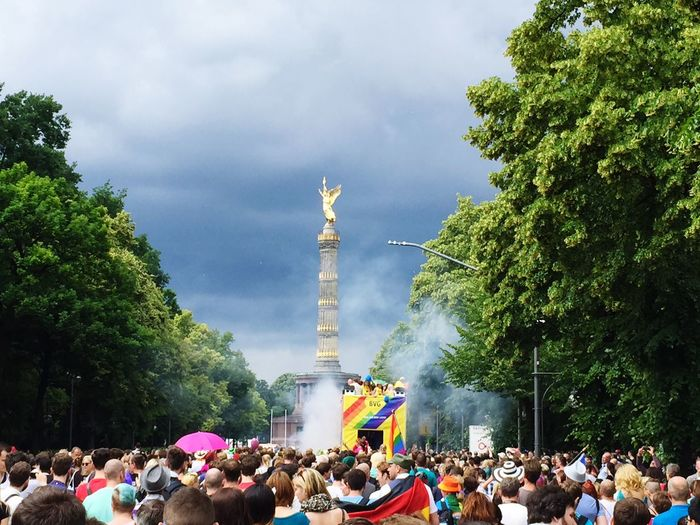 Rear view of crowd in parade at berlin victory column