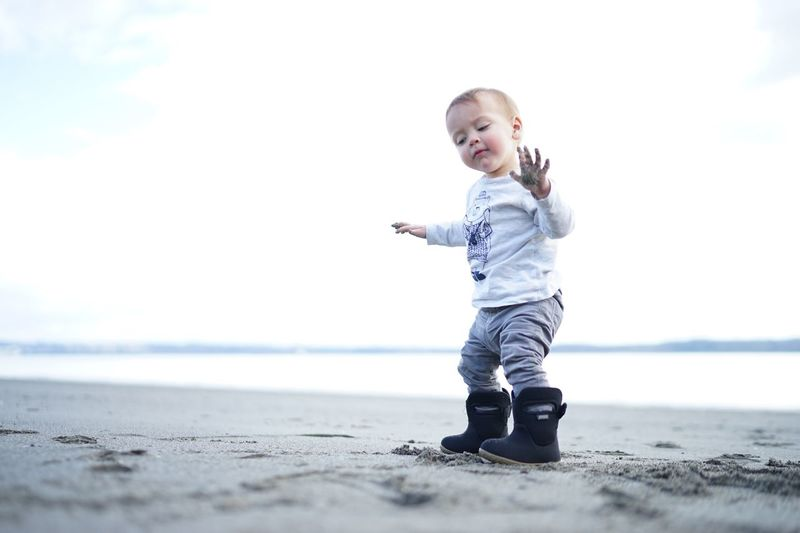 My little man. Full Length Casual Clothing Beach One Person Innocence Baby Babies Only Childhood Sky People Outdoors Sea Day Happiness Toddler  Cute Cheerful Real People