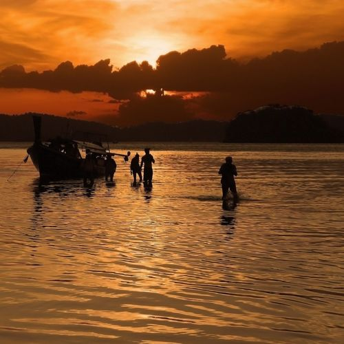 Sunset Silhouette Water Outdoors People Adult Nature Sky Day Orange Sky Sea Boat Islandhopping Krabi Thailand Dawn