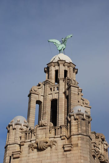 The upper parts of the iconic liver building in liverpool, uk