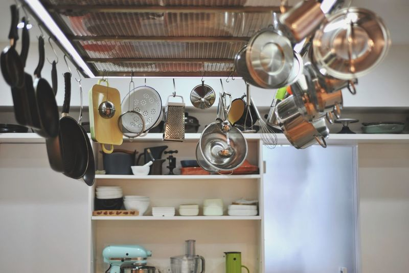 Low angle view of utensils hanging in kitchen