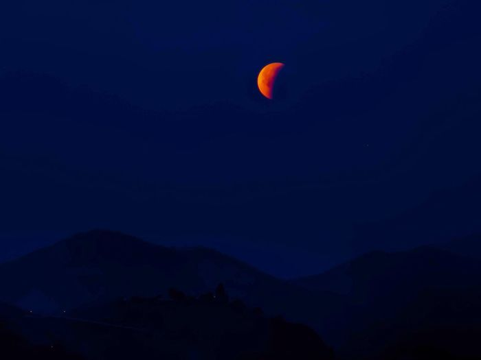 Super blue blood moon eclipse Blue Moon Blood Moon Night Flying Nature Mid-air Outdoors Adventure Sky Astronomy Beauty In Nature Mountain