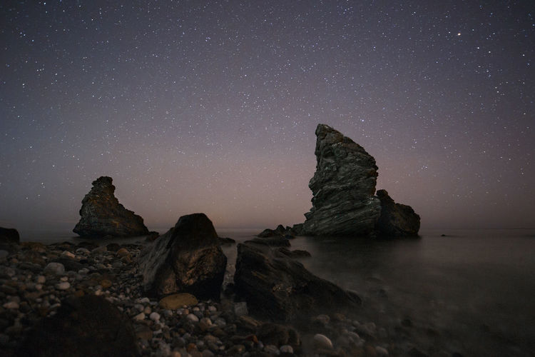 Rock Astronomy Star - Space Sky Rock - Object Space Night Scenics - Nature Rock Formation Beauty In Nature Tranquility Tranquil Scene Galaxy Star Star Field Nature Sea No People Milky Way Outdoors