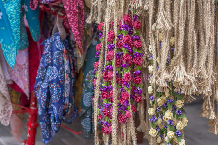 Close-up of textile and decoration hanging for sale in market
