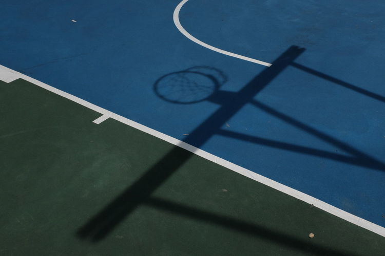 Shadow Of Basketball Hoop On Court