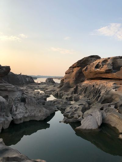 Sunrise from view at Sam Pun Bok Thailand grand canyon at Ubonratchathani Sky Water Nature Sunset Scenics - Nature Rock Beauty In Nature Cloud - Sky No People Rock - Object Rock Formation Land Outdoors Reflection