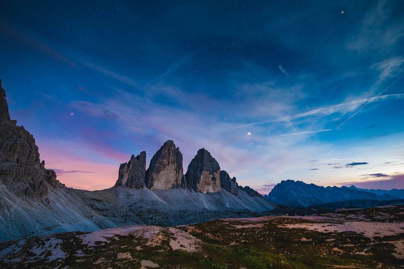 Scenic view of mountains against sky during sunset. tre cime di lavaredo, dolomites