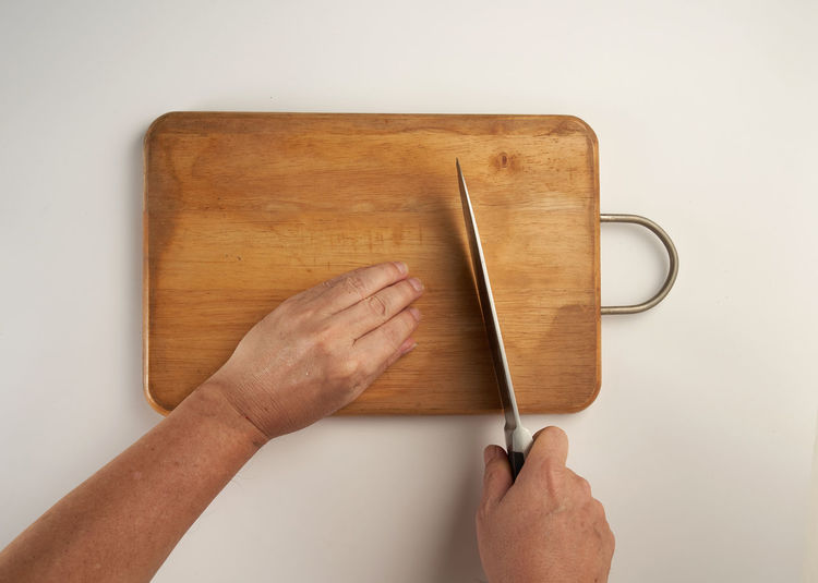 Directly above shot of person preparing food on table