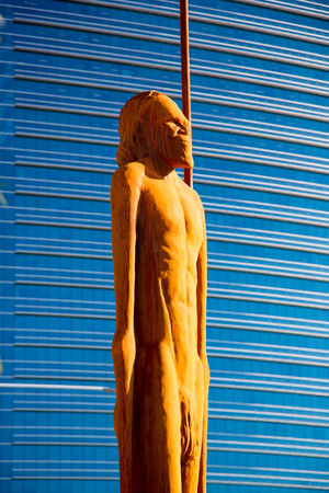 Aboriginal Architecture Art And Craft Blue Building Building Exterior Built Structure Craft Creativity Day Human Representation Low Angle View Male Likeness Memorial No People Outdoors Representation Sculpture Statue Wall - Building Feature