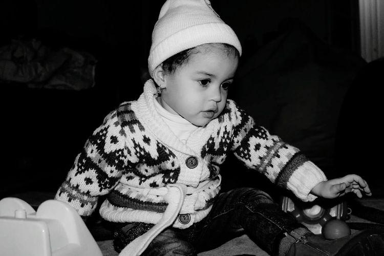 Girl wearing knit hat looking down