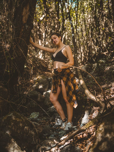 Adult Adults Only Beautiful Woman Beauty Beauty In Nature Day Fashion Model Forest Leisure Activity Looking At Camera Nature One Person One Young Woman Only Outdoors Portrait Real People Standing Tree Women WoodLand Young Adult Young Women