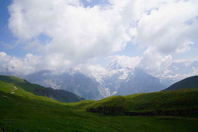 Beauty In Nature Cloud - Sky Day Environment Grass Green Color Idyllic Land Landscape Mountain Mountain Peak Mountain Range Mountain Ridge Nature No People Non-urban Scene Outdoors Scenics - Nature Sky Tranquil Scene Tranquility